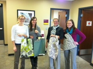 the women of the University of Minnesota's Athletic Department wearing their DIY tote bags!